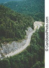 Road in Austrian Alps. Vintage film look.