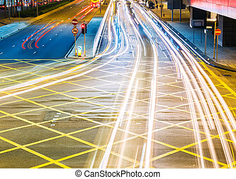 Road in city light trails