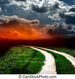 Road in field with clouds