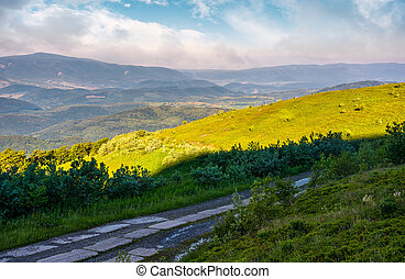 road in high mountains in summer morning. beautiful nature...