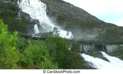 Road in Norway passing over the waterfall Langfoss. National tourist route