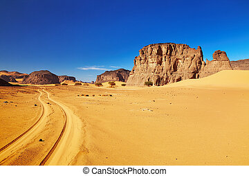 Desert landscape with rocks and blue sky, Tadrart, Algeria