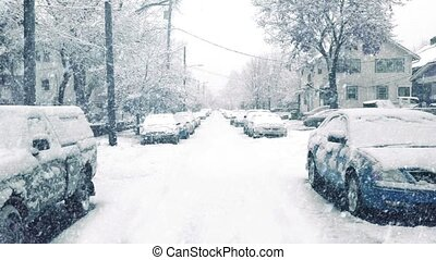Road In Suburbs In Snowstorm - Road through suburban area ...