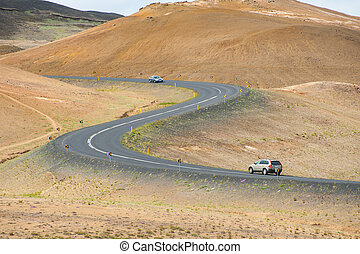 Road in the Iceland - Road with cars leading through the...