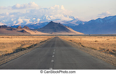 road in the mountains of Mongolia. one of the few asphalt roads