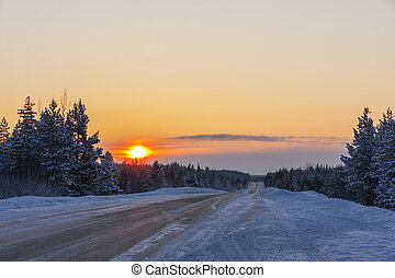 road in winter at sunset
