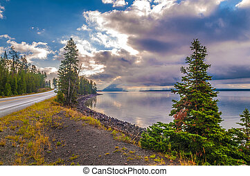 Road in Yellowstone and Rays of Light over the lake