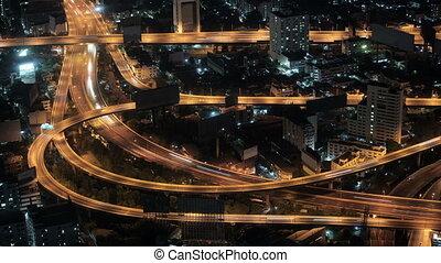 Road interchange in night city.