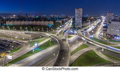 Road interchange of People Militia street, Mnevniki street and avenue Marshal Zhukov timelapse in Moscow at night