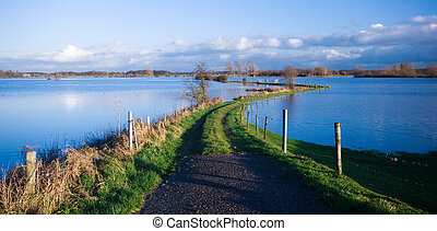 road into a flooded river - a road into a flooded river...