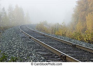 Road into nowhere - Railroad track into fog