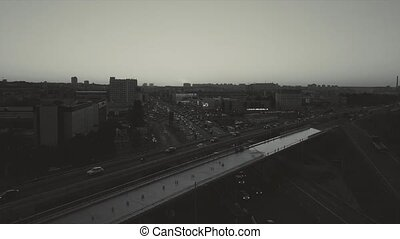 Road junction, at sunset rush hour, black and white video fast-track