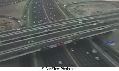 Road junction in Dubai at sunset view from airplane stock footage video