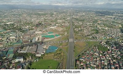 Road junction in Manila, Philippines. - Aerial view of...