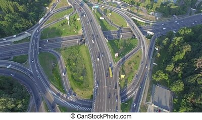 Road junction with heavy traffic in Kyiv, Ukraine. Paton Bridge. View from above