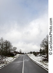 road landscape in winter with snow