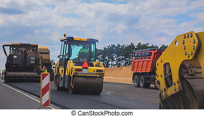 Road machinery on the construction of a road - Road ...