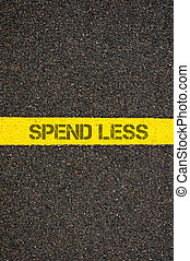 Road marking yellow line with words SPEND LESS