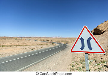 Road narrows both sign in Morocco