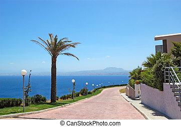 Road near luxury villas and Aegean Sea view, Crete, Greece