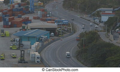 Road Next to Shipyard - Steady, aerial, medium wide shot of ...