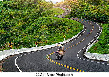 Road no.3 or sky road over top of mountains with green jungle in Nan province, Thailand.