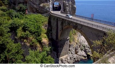 road of Amalfi coast, Italy - car driving on famous...