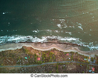 Road on coastline aerial view