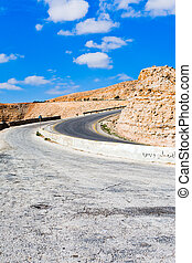 Road on mountain pass in Jordan in sunny day