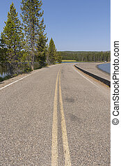 road on the water of Yellowstone lake in Yellowstone National Park
