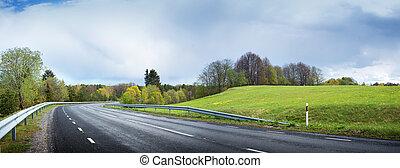 Road panorama on rainy day