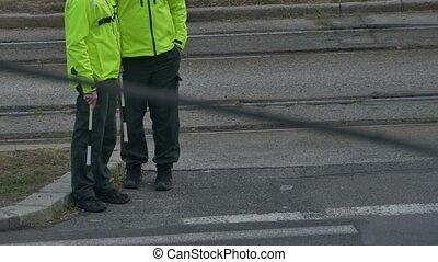 Road Policemen Waiting - Two traffic policemen waiting in...