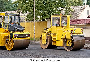 road repair, compactor lays asphalt