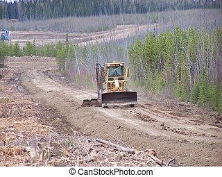 Road repair - Grader busy upgrading oilfield road.