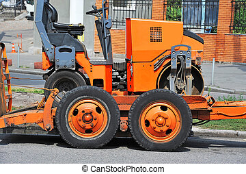 Road repair machine - Red road repair machine on city street