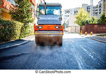road repairing in urban modern city with heavy vibration ...
