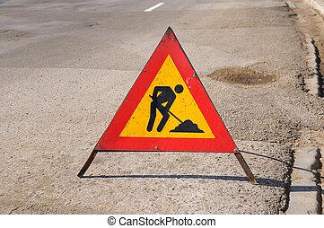 Road repairing sign - Detail of raod with repairing sign...