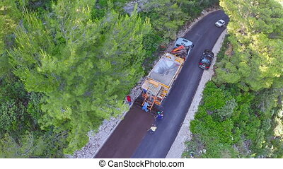 Road resurfacing on Island Mljet, aerial - Copter aerial...