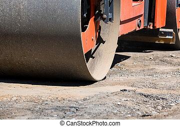 Close-up image of roller compactor at asphalt road repairing