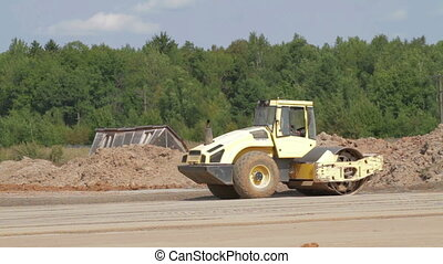 Road roller doing construction road - Road roller doing road...