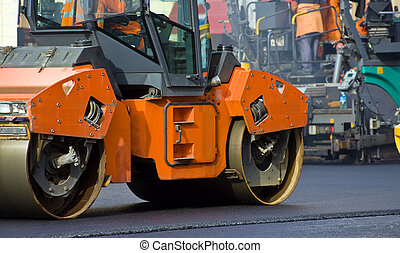 Road roller repairing asphalt pavement
