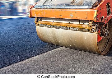 Road roller repairing asphalt pavement