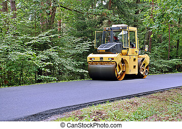 Road roller - road roller in the forest
