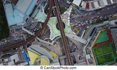 Road roundabout with car lots in the city in Thailand.Sixth...