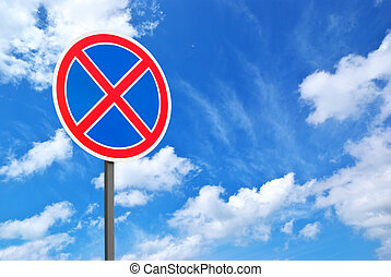 Road sign and blue sky