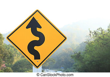 road sign beside curve mountain