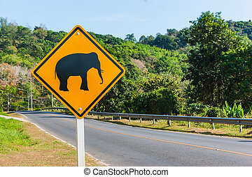 """Road sign """"caution elephants"""" on the track in Thailand"""