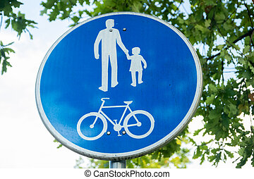 Road sign for bikes and pedestrians. Blue round traffic sign for safety.