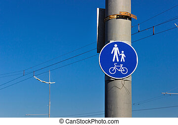 road sign for bikes and pedestrians path