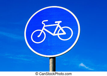 Road sign for bikes lane against the blue sky